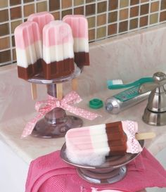 Fun DIY Neapolitan soap popsicles. These are soap - how cute.  Makes a great house warming gift.  Looks like they have it in a old tooth brush holder.