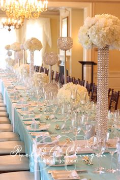 Tiffany Blue & Bling Tablescape My dream colors: Tiffany blue, pastel creamy orange and grey. Girls in tiff blue dresses with orange rose bouquet, boys in gray tuxes with tiff blue handkerchiefs and orange rose boutonnières.  Would be cool with fushia orchids and pale pinkish table cloths/chair covers