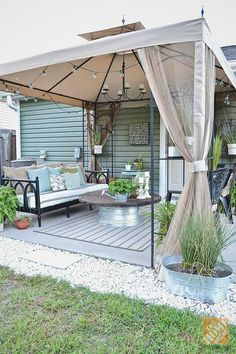 Blogger @Lizmarieblog.com transformed the look of her patio with a simple gazebo and lots of plants!