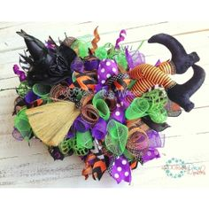 Halloween Table Centerpiece with witch legs, hat and broom. Craftoutlet.com photo contest entry by Adoorable  Deco Wreaths