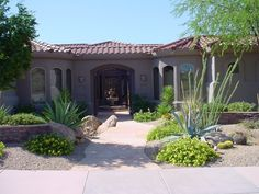 Currently obsessed with landscaping our front yard.  This simple, sparse xeriscape is what we're going for!