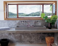 a panoramic view bathroom with cast-concrete counters and sink