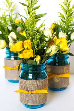 Mason jar wedding idea | wrap printed burlap around a jar and fill with your favorite flowers. Pin this to one of your boards with hashtag #heritageblue for a chance to win a jam maker and case of these jars!