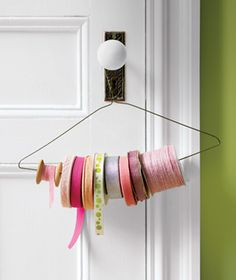 ribbon storage, clothes hangers, organizing tips, gift wrapping, ribbons, photo galleri, wire hangers, hanger craft, craft studios