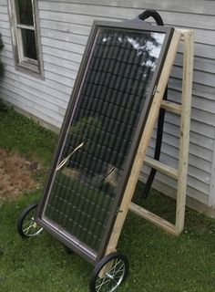 DIY solar heater made from soda cans. Should be enough heat for a green house.