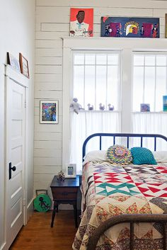 white. iron bed. quilts.