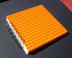 Spiral Bound Journal made with bright Orange Lego (r) plate by Miss Couraegous on Etsy