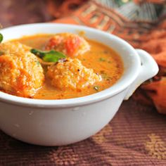 Lentil balls in tangy tomato and coconut curry.