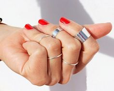 So fun and cute! If you love stacking rings, you must have this set! Extremely versatile they can be worn in many different ways—stack them, mix and match metals colors , or simply rearrange them to create a new look every day. This list is for one set of 5 rings: 3 knuckle rings: one thin, two cuffs and 2 simple adjustable regular rings rings. Full Look ( silver & gold ring set's) available here: ...