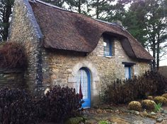 Thatched roof cottage, France