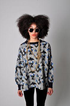 80s 90s Leopard Print Sweatshirt Medium/Large. $25.00, via Etsy.