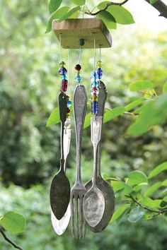 Garden Ideas: A handmade wind chime, fashioned from old utensils and colorful beads, adds whimsy and—with a gentle breeze—soothing sounds.