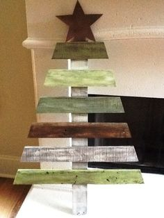 Distressed Wooden Christmas Tree. $40.00, via Etsy.- @Rachael Ward @Abby Christine Maeger This one you can just stick in the flower bed...