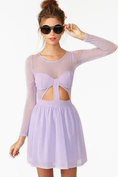 The first Nasty Gal Collection is finally here! Awesome lilac mesh skater dress featuring sheer detailing and a cutout waist. Plunging v back, side zip closure. Partially lined, hidden tulle layer at skirt. Looks super cute with circle shades and Docs! A limited edition piece by Nasty Gal!