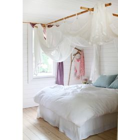 Beatiful bedroom with draped muslin - so easy.