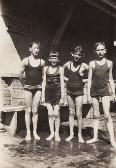 Four boys at a swimming pool, 1920s