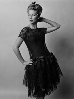 Tania Mallet in black lace dress