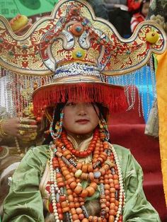 Tibet | Portrait of a woman wearing an incredibly expensive and heavy ceremonial costume during the King Gesar Arts Festival / Khampa arts festival in the Kham region of Tibet in 2004 | © BetterWorld2010, via flickr