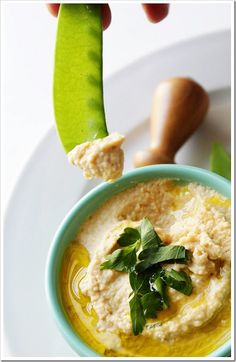 """Homemade Hummus  Homemade hummus is another one of those recipes that is so easy to make super fresh at home.  I've made a lot of hummus over the years, and in my research I learned a trick to making really creamy (as opposed to """"grainy bean mash"""") hummus. Yes, we have a trick to share with you! It's easy."""