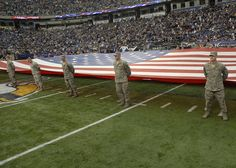 The Minnesota Vikings saluted military Servicemembers and veterans during their annual Military Appreciation game at the Mall of America Field in Minneapolis, Nov. 20. The large flag at mid-field was presented by Minnesota National Guard Citizen-Soldiers and –Airmen who have returned from combat in the last year.   (U.S. Army photo by Master Sgt. Rich Kemp)  http://www.minnesotanationalguard.org/press_room/e-zine/articles/index.php?item=3573