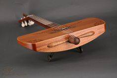 """New Ukiyo Aero-Uke. """"Believe it or not, Harmony made the original version of this uke back in the days when Lindberg's flight across the Atlantic made anything shaped like an airplane a hot seller. The Marc Schoenberger (Ukiyo) version is of far better construction, and actually sounds quite good. It's a real musical instrument..."""""""