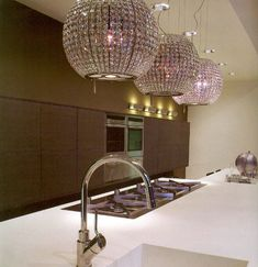 Ventilation hood disguised as bling lighting for the kitchen! Fantastic!