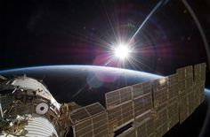 Sun over Earth by NASA