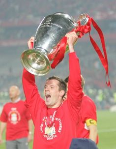 Jamie Carragher celebrates after Liverpool beat AC Milan to win the European Cup