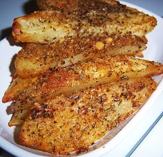 Baked Parmesan Crusted Potato Wedges: Easy to make and yummy! After putting the potatoes in a bag with olive oil, I put them in a bag with the other ingredients to make sure they were coated well. Then I put more parmesan cheese on top once they were on the baking pan!