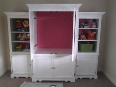 """The Copy Cat Home: This entertainment center was turned into a toy center.  I'm thinking if there was room behind it """"safely of course"""" the big cabinet's back could be removed for a play """"theater"""" for puppet shows.... or just put the kids tv in it.... either way!  :)  Craft Supply & Demand #upcycled #entertainment #center or #armoire"""