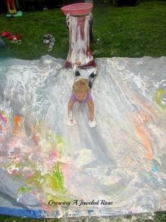 The ultimate shaving cream sliding experience.  We added a tarp and a hill to our original shaving cream slide, and it was AMAZING!  You simply must try this!