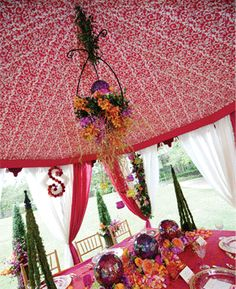 Gypsy Faire Tent inspired by middle eastern nomadic tent design. Floral design by Kimberly Nelson. Photography by Frank Carnaggio. As seen in Alabama Weddings Magazine.   Keywords: #weddingtents #jevelweddingplanning Follow Us: www.jevelweddingplanning.com  www.facebook.com/jevelweddingplanning/