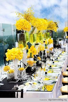 #yellow wedding table ... Gorgeous black & yellow wedding theme and table centerpiece ideas althought I'd make a theme with my favorite color which is yellow and my fiances whatever it will be lol.