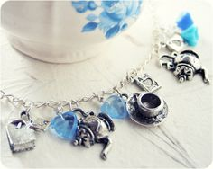 Tea party Charm Bracelet... would this not be a cute idea for a girl's birthday party favor???  I will have to remember this when David and I are blessed with a Granddaughter...  ( I pray)...