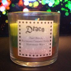 Malfoy Scented 4oz Candle- Tart Apple, Slytherin Common Room, and Hawthorn Wand from Mud In My Blood ..i think i need this.