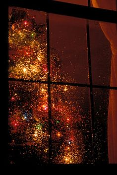 Looking through a Christmas window at night.....