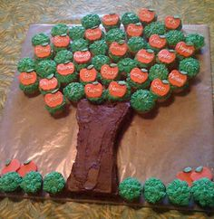 """This would be cute if you made the apples using the """"What's New Cupcake"""" apple cupcake recipe and plain green frosted cupcakes for the leaves.  The trunk looks like a cake sliced into a trunk-shape."""