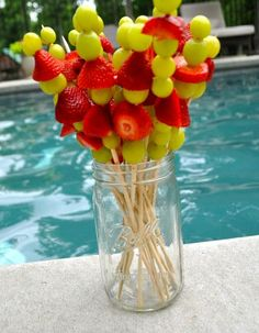 Like the presentation of the fruit kabobs to add some nutrition at my wedding or for those who don't do cake