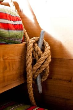 Cool nautical bed idea with rope and cleat.