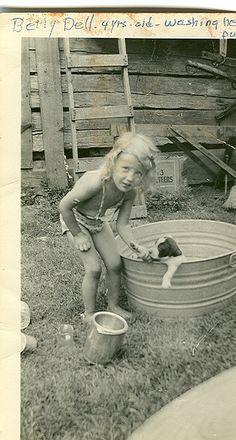 Little girl washing a puppy (1942)