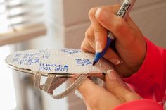 #Bridesmaids writing messages to the #bride on her shoes! #somethingblue #wedding