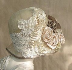 so pretty. Love the silk flowers and lace on this hat.