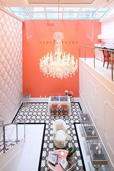 Another view of the bridal salon, decorated with a glittering Schonbek chandelier! salon decorating, wall colors, quilt wall, color schemes, boutique decoration, bridal salon decor, bridal boutique colors, wall lighting, bridal boutique decor