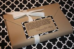 Wrapping a book -- brown kraft paper and a quote from the book as a tag