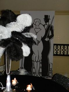 Ostrich feather centerpieces. Beads, hats and glasses hand out at the door? 1920s decorations, birthday parties, 20s parti, feather centerpiec, roar 20s, 1920s party, roaring 20s centerpieces, 1920s theme, roaring 20s party