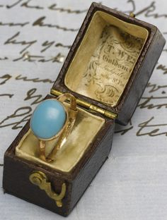 The Jane Austen ring that was put up for auction by Sotherby's - enough to send chills up my spine!  A lovely cabochon natural turquoise in simple gold setting.  Amazing provenance.