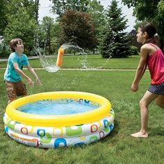 """Games That Make a Splash - Back-to-back Balloon Dash (Four or more players)  Players choose partners, then stand back-to-back, arms interlocked, at the starting line. Place a water balloon between each pair. At """"Go,"""" teams race to cross the finish line without breaking the balloon. The first to do so wins."""