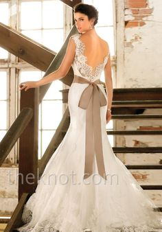 Gown features lace and detachable lace overlay.