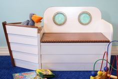 Nautical Wooden Boat Bench Toy Box in White with Anchor: Free Personalization with Purchase. Personalization comes with child's name and city. $325.