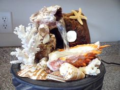 shell craft, water fountain, shell fountain, shell art, sea shell